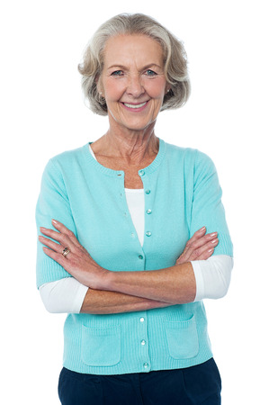 Confident smiling beautiful aged woman in trendy wear photo