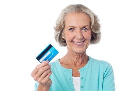 Senior woman displaying her cash card