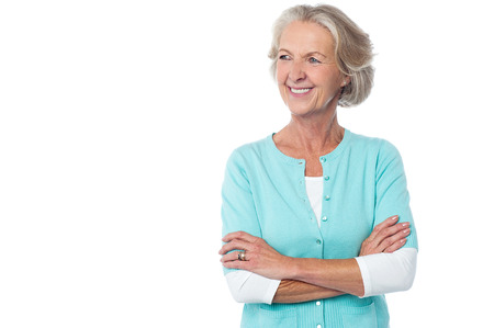 lifestyle looking lovely: Confident aged woman in casuals, arms crossed.