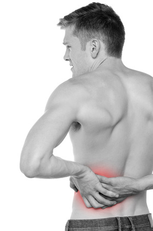 reddening: Young man holding his back in pain