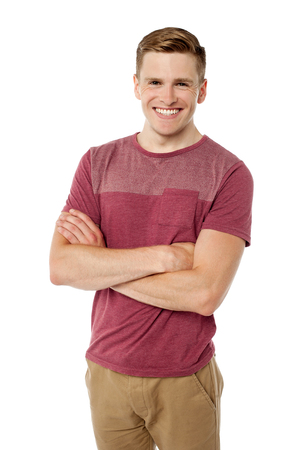 Cheerful young guy posing with folded arms Stock Photo - 22567166