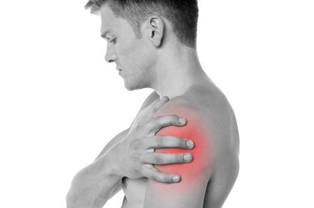 epaule douleur: Jeune homme ayant épaule douleurs articulaires Banque d'images