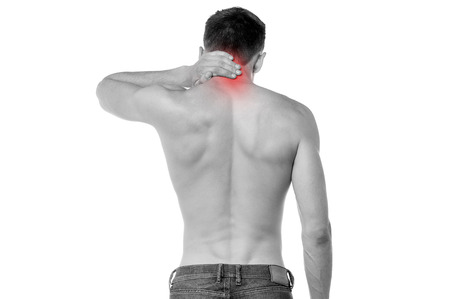 Young man having pain in his neck Stock Photo - 22567690