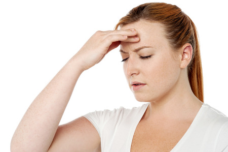 Woman suffering from severe headache photo