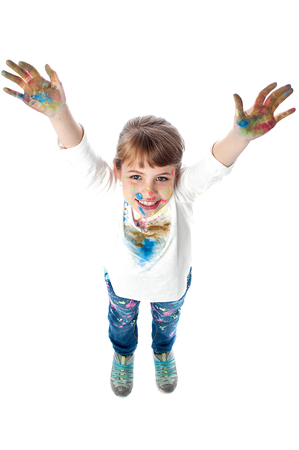 painted hands: Little girl with painted hands, aerial view