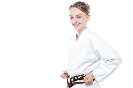 karate: Little girl kung fu expert is ready for action Stock Photo