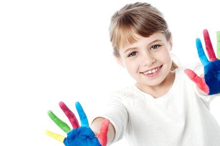 painted hands: Portrait of a cute girl with painted hands