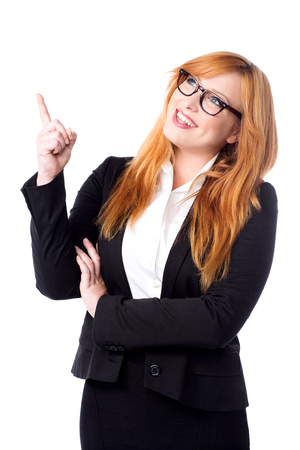 Young corporate lady looking and pointing upwards Stock Photo - 22578618