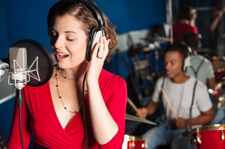 Female playback singer recording a track photo