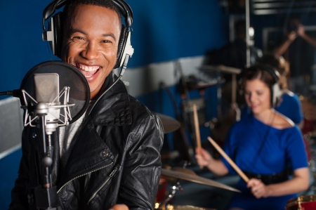 female singer: Male singer recording a track in studio Stock Photo