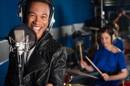 sound recording: Male singer recording a track in studio Stock Photo