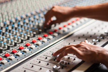fader: An expert adjusting audio mixing console
