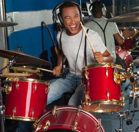 Drummer in action inside recording studio