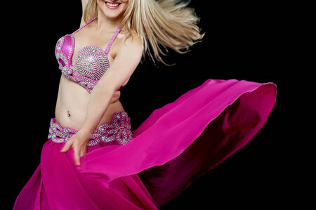 Beautiful smiling exotic isolated belly dancer photo