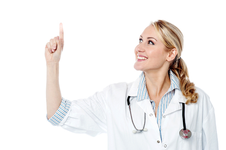 Female surgeon pointing towards something photo