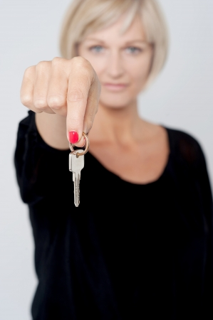 Woman offering you office key photo