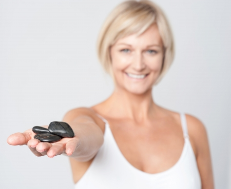 inner wear: Lady showing lastone therapy stones Stock Photo
