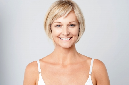 Beautiful middle aged woman smiling warmly photo