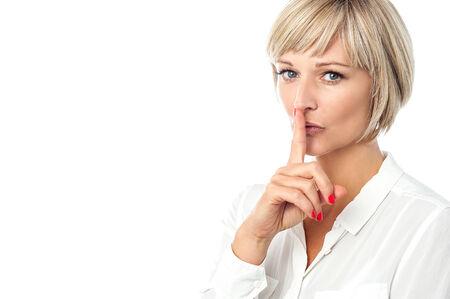 calm woman: Pretty calm woman gesturing silence