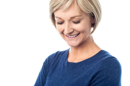 Isolated shy smiling middle aged lady