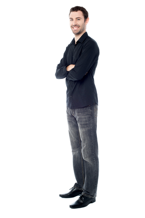 Smiling guy in casual wear, arms crossed  photo