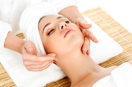 facial massage: Spa face massage, facial treatment in spa salon Stock Photo