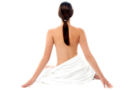 Back pose of a naked woman isolated over white photo