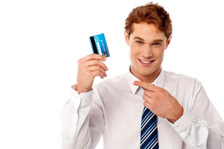 debit card: Young corporate guy displaying his debit card