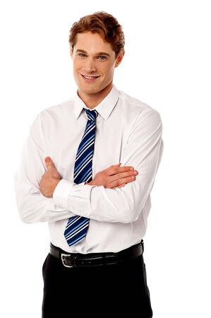 Young male businessman posing confidently photo