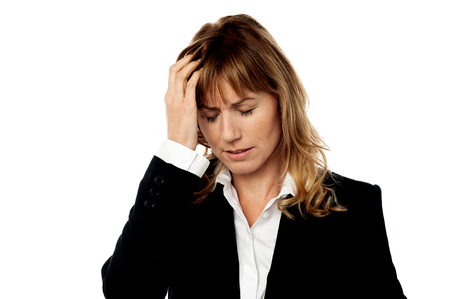Businesswoman applying gentle pressure on head photo