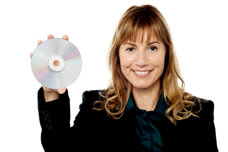 Corporte lady executive holding a compact disc photo