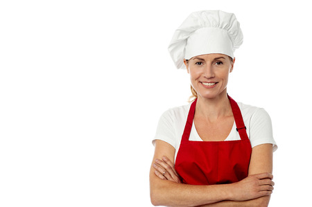half dressed: Charming female chef wearing red apron and toque Stock Photo