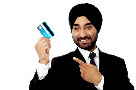 debit card: Young corporate man holding debit card