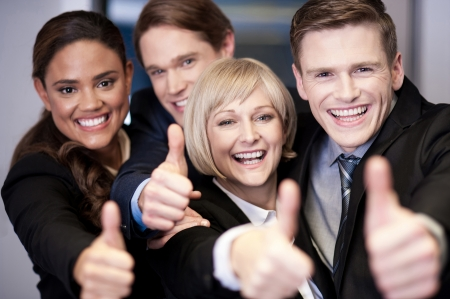 Successful corporate team showing thumbs up Stock Photo