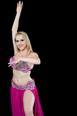Sexy woman performing belly dance move photo