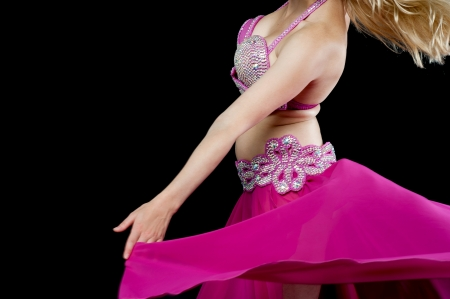 Cropped image of a belly dancer performing photo