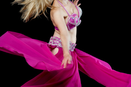Belly dancer wearing fashionable pink dress photo