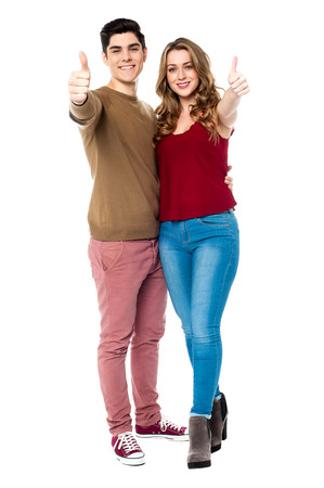 yup: Young couple showing double thumbs up