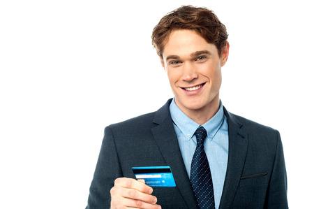 debit card: Young corporate guy chersihing his debit card Stock Photo