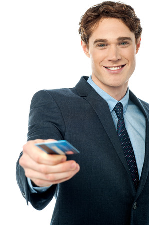 debit card: Young businessman offering you debit card