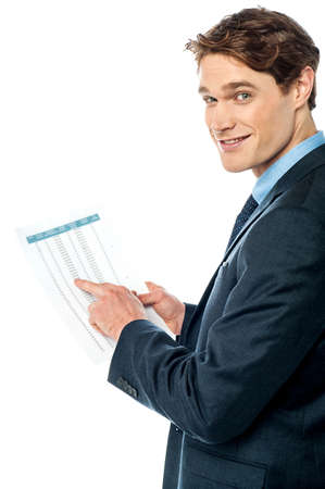 Handsome manager checking financial report photo