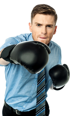 Businessman in punching posture photo