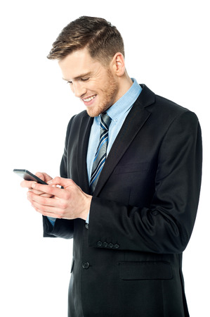 operate: Corporate guy sending text message