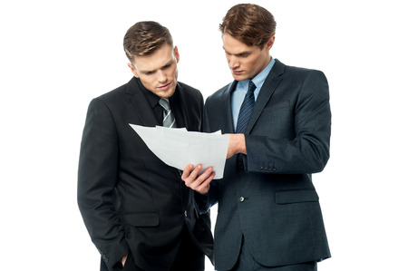 Serious business executives checking documents Stock Photo