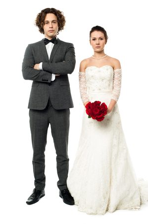 Young married couple, full length portrait photo