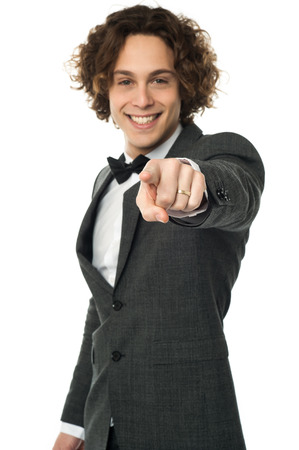 formals: Young guy in formals pointing his index finger Stock Photo