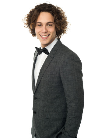 Handsome young man in a smart tuxedo