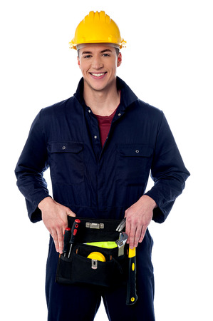 Smiling handyman isolated over white photo