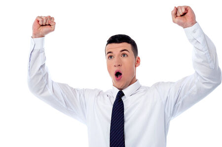 Excited corporate guy clenching his fists photo