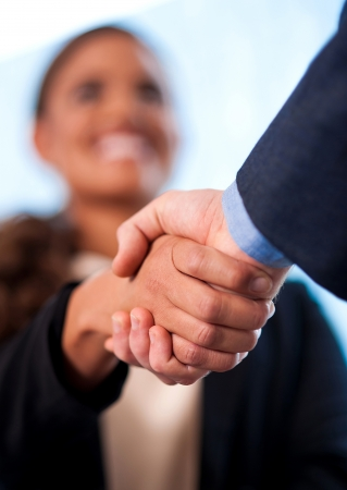 business handshake: Image of two business people shaking hands